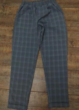 Стильные женские брюки в клетку