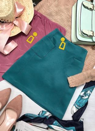 Стильная юбка красивого цвета  с карманами