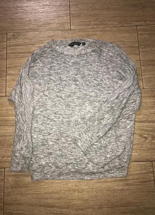 Шикарный свитер меланж,с вырезами на плечах