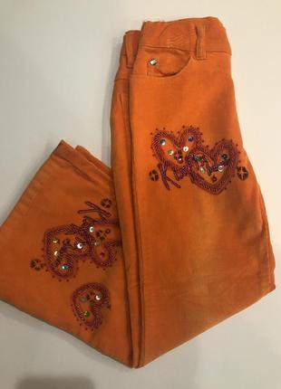 Вельветовые оранжевые брюки для девочки