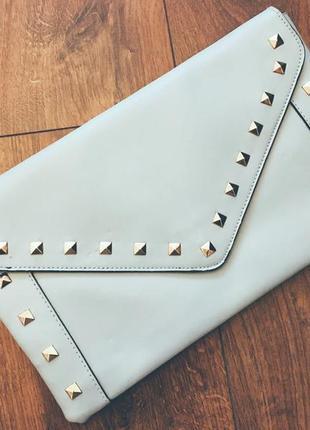 Клатч красивого бледно голубого цвета