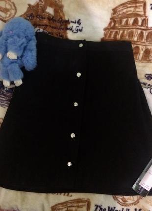 Замшевая чёрная юбка на заклёпках