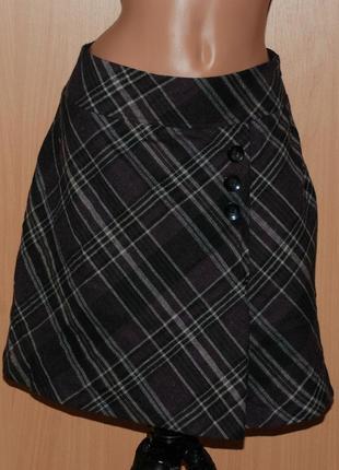 Шерстяная юбка бренда  blue motion с декоративными пуговицами спереди и клинчиком сбоку.