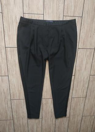Стильные зауженные брюки с лампасами
