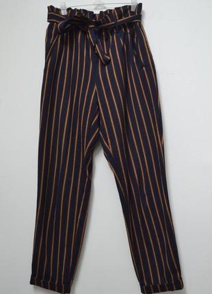 Теплые брюки  под почс в полоску