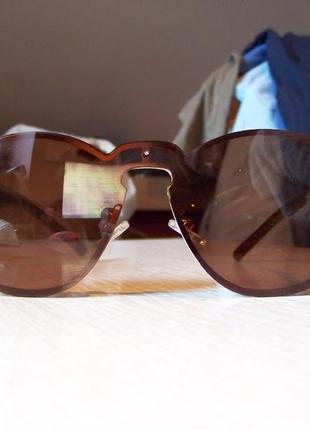 Безободковые стильные солнцезащитные очки унисекс дымчатые шоколад италия4 фото