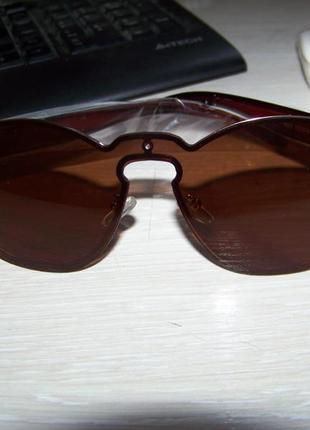 Безободковые стильные солнцезащитные очки унисекс дымчатые шоколад италия5 фото
