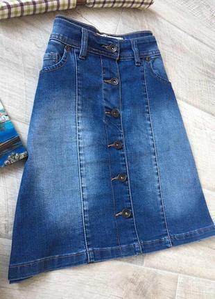 Голубая джинсовая юбка трапеция с пуговицами
