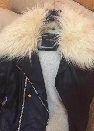 Шкіряна зимова куртка