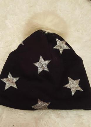 Синяя шапка со звездами и с бубоном на флисе