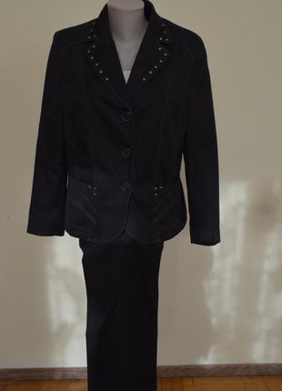 Красивый элегантный брендовый брючный костюм котон 67 % с заклепками