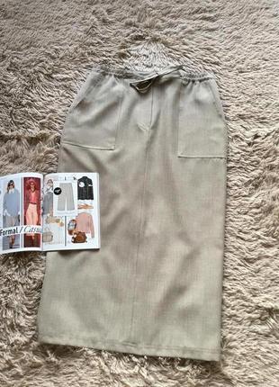 Длинная юбка с накладными карманами