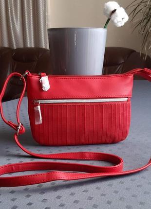 Новая красивая красная сумка кроссбоди фирмы avon