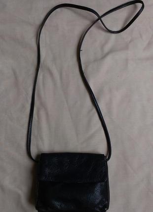 Кожаная сумочка с тиснением по коже