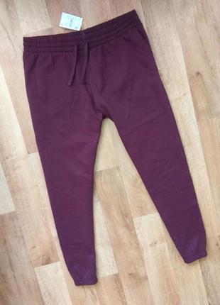 Новые с бирками мужские брендовые спортивные штаны бордового цвета l  размера.