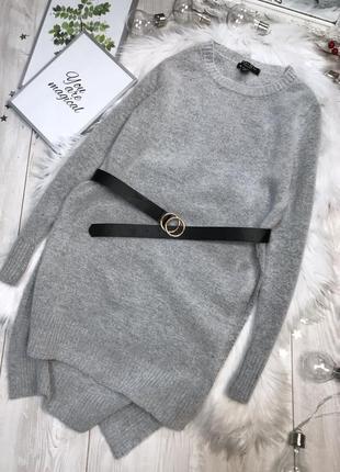Удлинённый свитер с разрезами