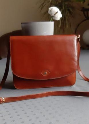 Кожаная красивая рыжая сумка на длинном ремешке