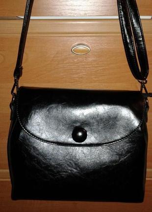 Продам черную сумку