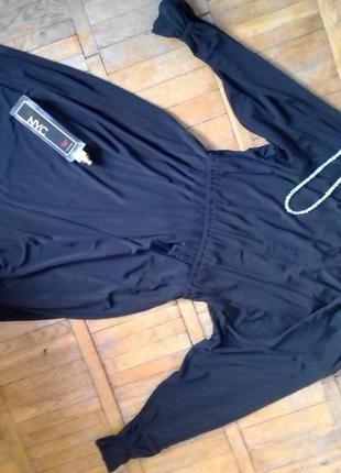 Стильнячее черное платье bgn