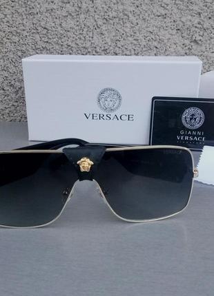 Versace очки женские солнцезащитные черные в золотой металлической оправе