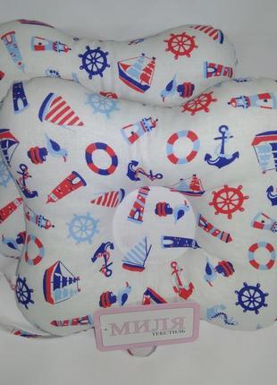 Подушка ортопедическая для новорождённых деток с хлястиком для соски.
