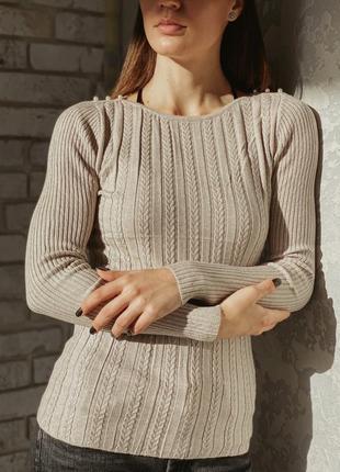 Нежный нарядный свитер косичка