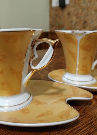 Набір горняток з блюдцями для кави