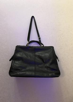 Кожаная дорожная сумка