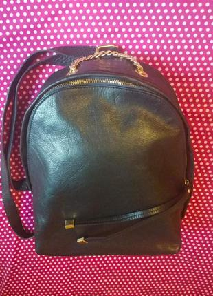 Кожаный вместительный рюкзак