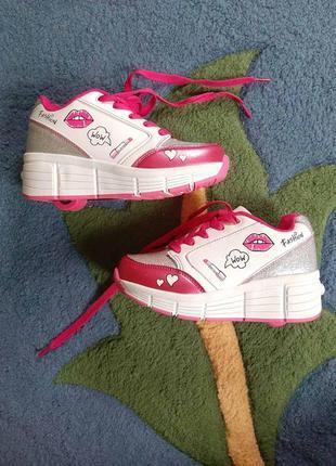 Новые классные кроссовки для девочки с выдвигающимися колесиками на пятке р. 33