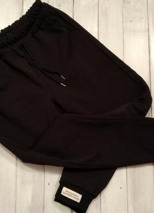 Теплые штаны с манжетом