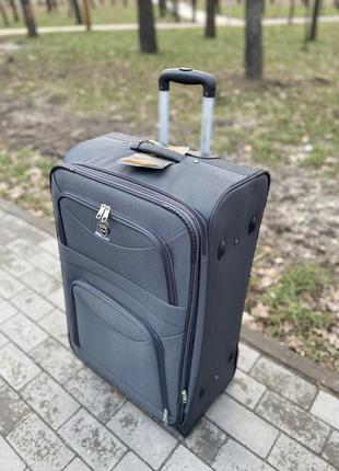 Большой чемодан на 2 колеса