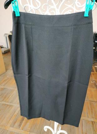 Женская однотонная юбка черная2 фото