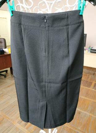 Женская однотонная юбка черная3 фото