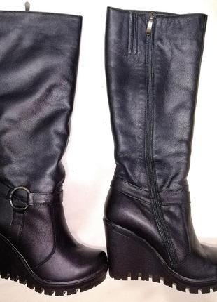 Кожаные высокие женские сапоги на платформе