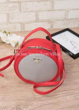 Круглая женская сумка через плечо david jones 5059 красная/серебро