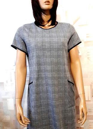 Стильное платье трапеция в клетку с накладными карманамиот select