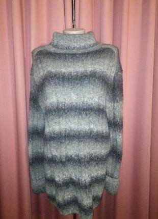 Меланжевый свитер в косы под горло