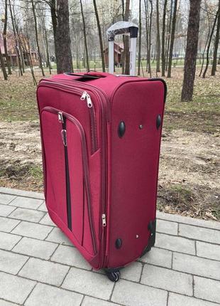 Большой чемодан на 4 колесах польша