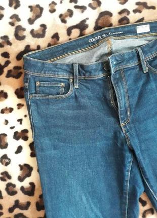 Темно синие джинсы на средней посадке colin's