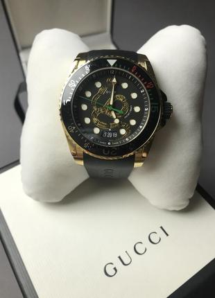 Новые gucci dive 45mm gold pvd king snake dial with rubber strap