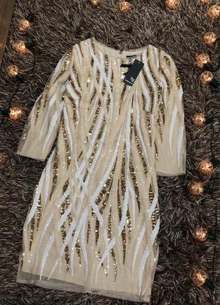 Стильное нарядное нюдовое платье в пайетках tfnc london