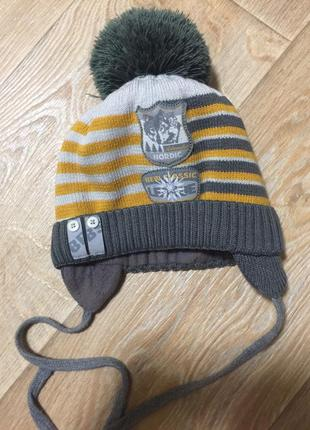 Теплая зимняя шапка на мальчика