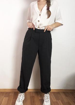Шерстяные брюки с защипами
