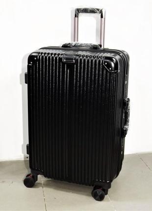 Средний пластиковый чемодан на 4 колесах putaian 2155-1 черный