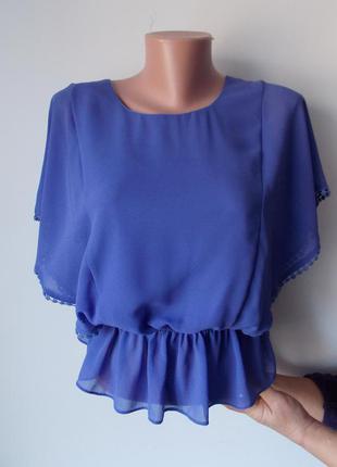 Сиреневая блузка с рюшами