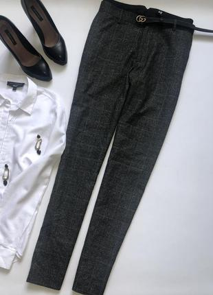 Стильные тёплые брюки в клетку на пышную модницу.