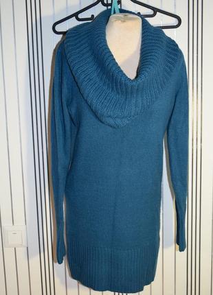 Довгий светр з великим горлом