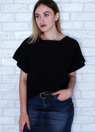Блуза с удлиненной спинкой  в черном цвете