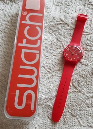 Швейцарские часы swatch алого цвета